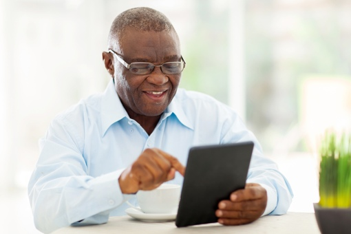 Man with glasses using tablet