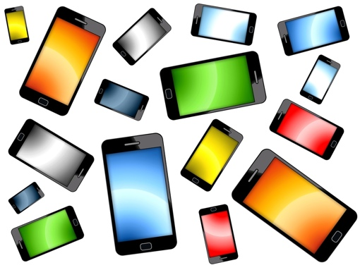 Multiple colored smartphones on a white background