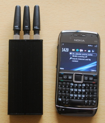 Illegal phone jammer next to a cellphone