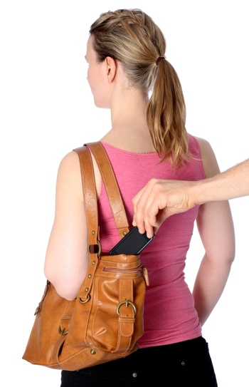 Woman's phone being pickpocketed