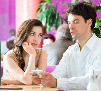 Couple on date distracted by smartphone