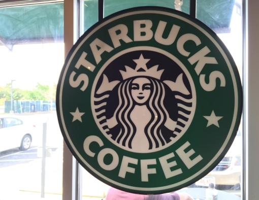 Starbucks Coffee sign in store window