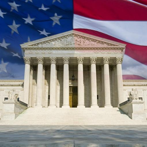 U.S. Supreme Court building w/flag background