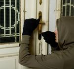 Thief picking front door lock