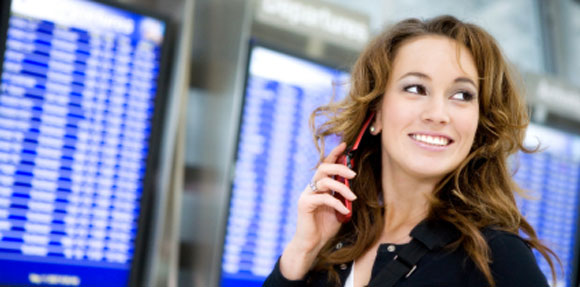 woman at airport with cell phone