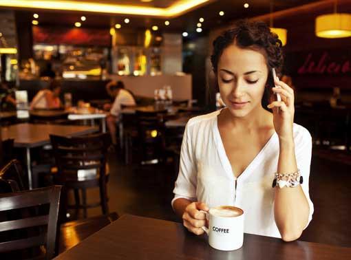 woman talking on cellphone via Shutterstock