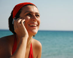 Woman on cell phone at beach