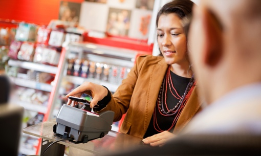 Woman paying at store with NFC