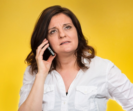Upset woman using a smartphone