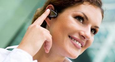 woman wearing bluetooth headset