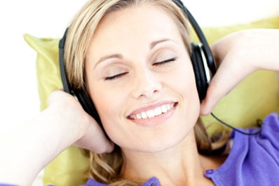 woman listening to music - Shutterstock