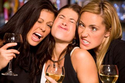 Women at bar making faces