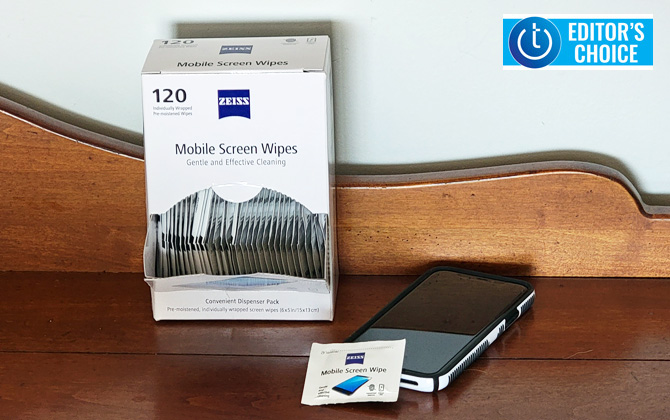Zeiss Mobile Screen wipes 120 count box on table with iPhone 11 Pro. One wipe packet is leaning up against the iPhone.